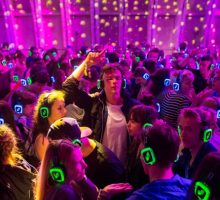 Festival goers dance at the silent disco stage during Open'er music Festival in Gdynia